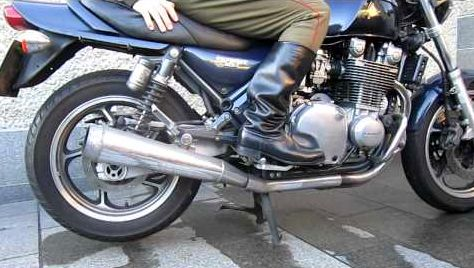 officer Russian boots on the motorcycle and uniform