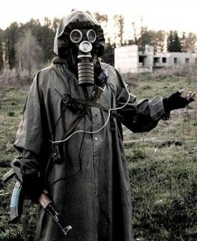 halloween Russian stalker style with Soviet gas mask and raincoat